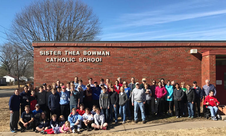 SLUH XC Serves at Sister Thea Bowman School